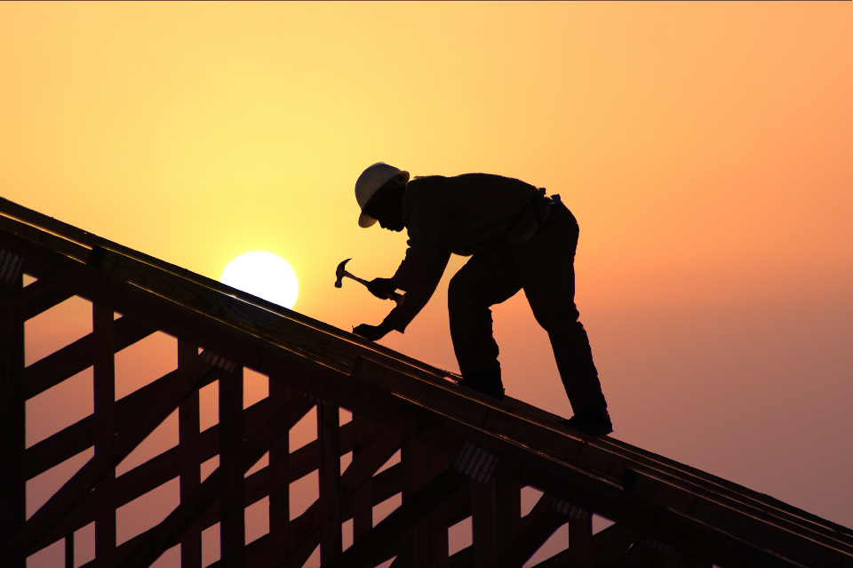 Sillouette of Man Hammering at Sunset | Kern County Builders' Exchange (KCBEX) | Bakersfield, CA